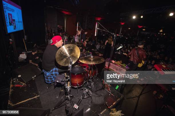 Drummer Chad Smith of the Red Hot Chili Peppers and Guitarist Mike McCready of Pearl Jam perform on stage during the MusiCares Concert For Recovery...