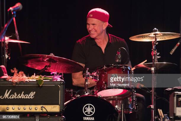 Drummer Chad Smith of the Red Hot Chili Peppers performs on stage during the MusiCares Concert For Recovery presented by Amazon Music at the Showbox...