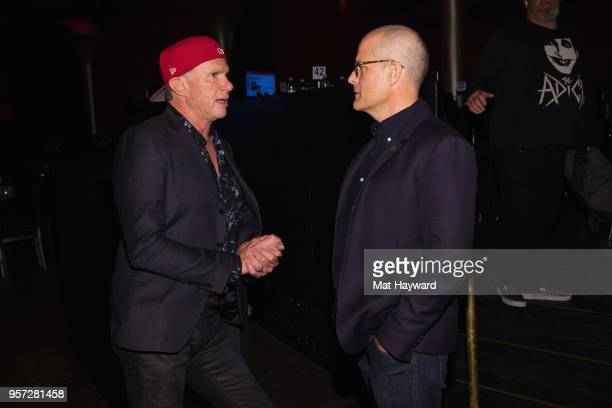 Drummer Chad Smith of the Red Hot Chili Peppers speaks with MusiCares Chair Michael McDonald during the MusiCares Concert For Recovery presented by...