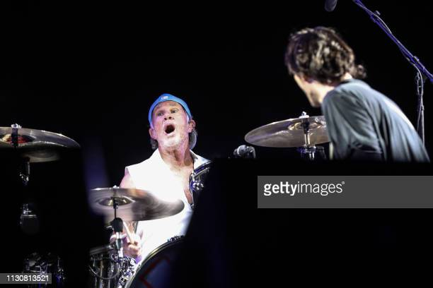 Drummer Chad Smith of the US rock band the Red Hot Chili Peppers performs during their concert by the Giza Pyramids on the western outskirts of the...