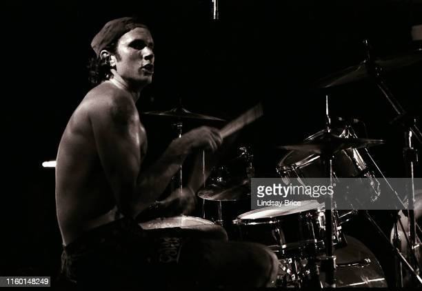 Drummer Chad Smith performs in Red Hot Chili Peppers for Rock for Choice at the Hollywood Palladium on September 27 1992 in Los Angeles California