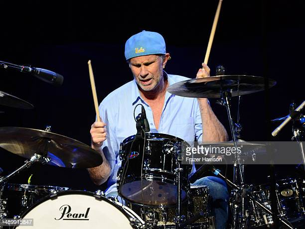 Drummer Chad Smith performs onstage at the 10th annual MusiCares MAP Fund Benefit Concert at Club Nokia on May 12 2014 in Los Angeles California