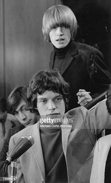 Drummer Charlie Watts, singer Mick Jagger and guitarist Brian Jones of the rock and roll band 'The Rolling Stones' at a press conference at the New...