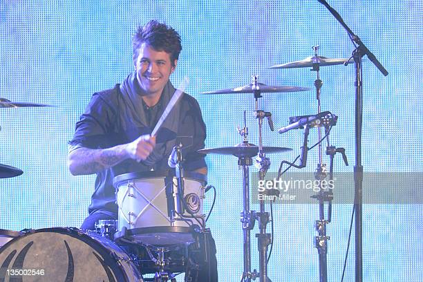 Drummer Chris Thompson of the Eli Young Band performs onstage at the American Country Awards 2011 at the MGM Grand Garden Arena on December 5 2011 in...