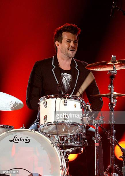 Drummer Chris Thompson of the Eli Young Band performs onstage during ACM Presents An AllStar Salute To The Troops at the MGM Grand Garden Arena on...