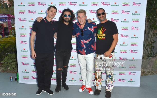 Drummer Dean Butterworth bassist Kristian Attard singer Mark McGrath and guitarist Rodney Sheppard of Sugar Ray arrive at the Flamingo Go pool at...