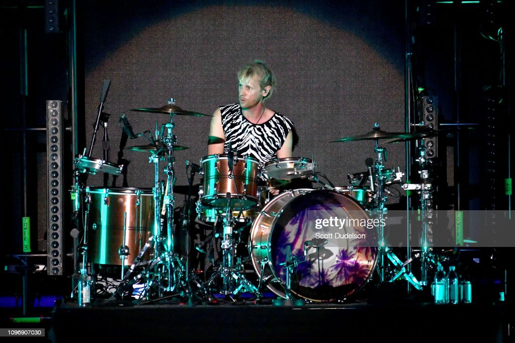 Drummer Dominic Howard of the band Muse performs onstage