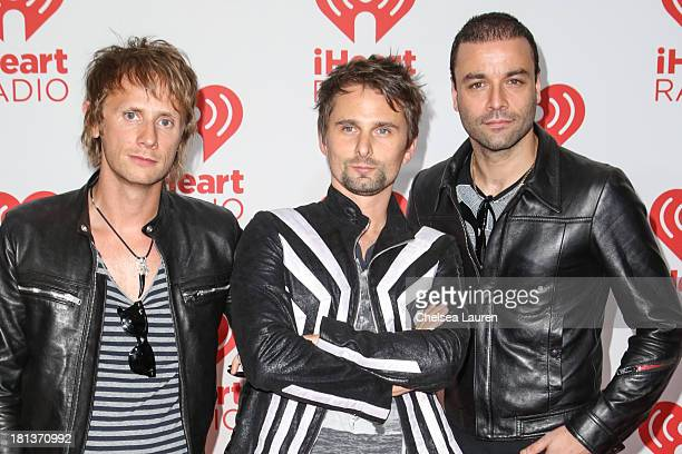 Drummer Dominic Howard vocalist Matthew Bellamy and bassist Christopher Wolstenholme of Muse pose in the iHeartRadio music festival photo room on...