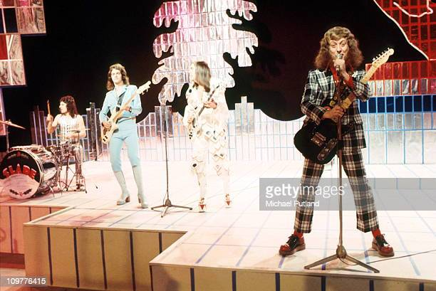 Drummer Don Powell bassist Jim Lea guitarist Dave Hill and singer Noddy Holder of Slade performing 'Cum on Feel the Noize' on the BBC television show...