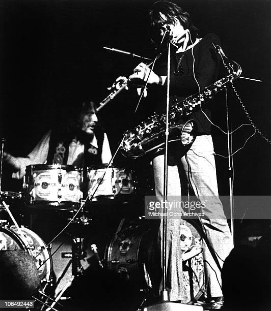 Drummer Ginger Baker and Chis Wood of the rock group Air Force perform onstage circa 1970