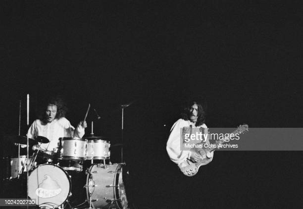 Drummer Ginger Baker and guitarist Eric Clapton of British rock band Cream in concert, circa 1967.