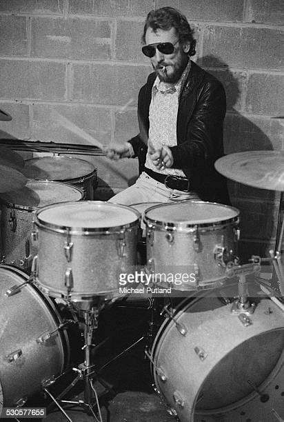 Drummer Ginger Baker, of English rock group the Baker Gurvitz Army, at his kit, December 1974.
