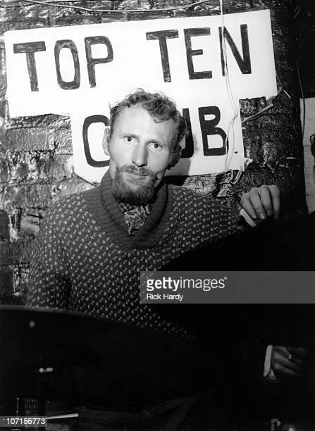 Drummer Ginger Baker poses behind his drum kit at the Top Ten Club in London in 1959