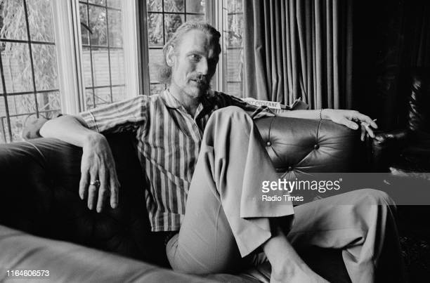 Drummer Ginger Baker relaxing in front of a large bay window, June 1973.