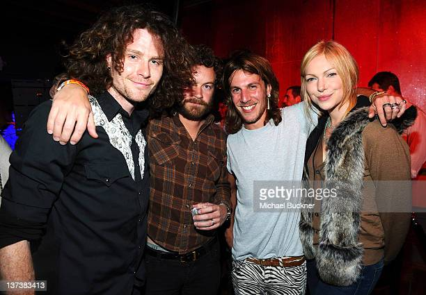 Drummer Harry Thynne of WIM actor Danny Masterson Martin Solomon of WIM and actress Laura Prepon attend the Open House at Bing Bar on January 19 2012...
