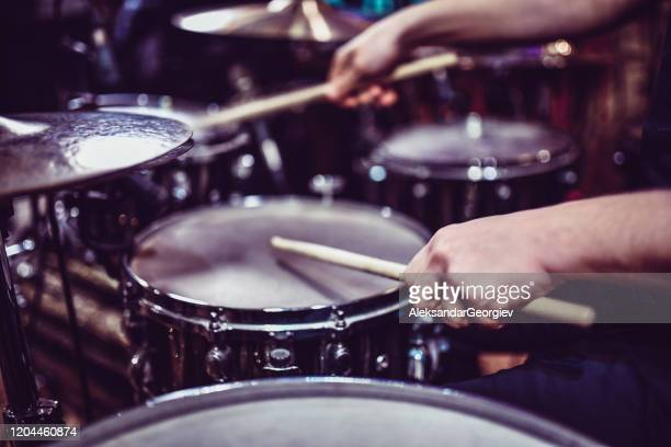 drummer hitting some snare drum rolls - drum kit stock pictures, royalty-free photos & images