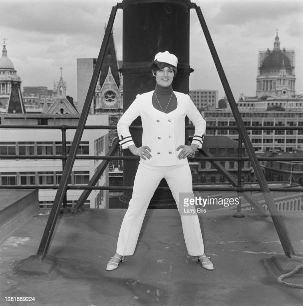 Drummer Honey Lantree of English beat group the Honeycombs wearing a white suit with a naval theme in London, UK, 13th July 1966.