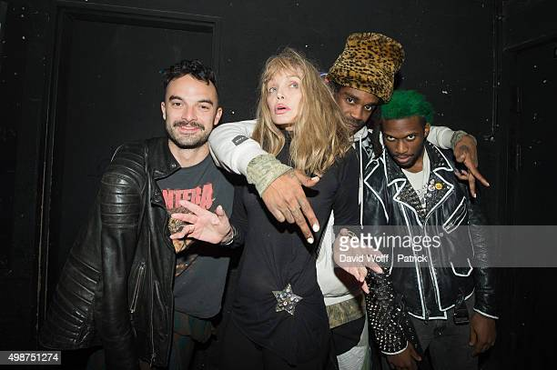 Drummer Ian Longwell TheOGM and Eadyy of Ho99o9 pose with Arielle Dombasle at Le Point Ephemere on November 25 2015 in Paris France