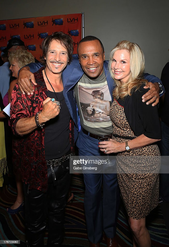 Drummer Jay Schellen, former boxer Sugar Ray Leonard and Barbara Schellen arrive at the 'Night of the Champion' event to honor former boxer Leon Spinks hosted by the cast members of 'Raiding the Rock Vault' at The Las Vegas Hotel & Casino on August 17, 2013 in Las Vegas, Nevada.