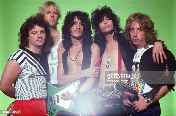 Drummer Joey Kramer guitarist Brad Whitford guitarist Joe Perry singer Steven Tyler and bassist Tom Hamilton of the rock group Aerosmith pose for a...