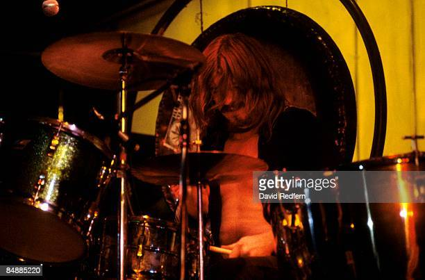 Drummer John Bonham of English rock group Led Zeppelin performs live on stage during the first of two performances by the group at the Knebworth...