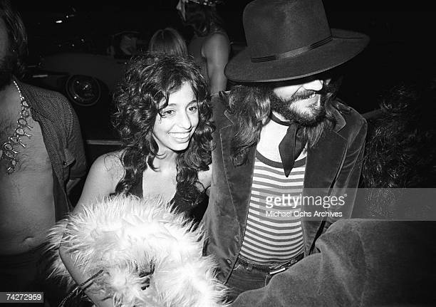 Drummer John Bonham of the rock band 'Led Zeppelin' arrives at Rodney Bingenheimer's English Disco with groupie Lori Maddox in June 1972 in Los...