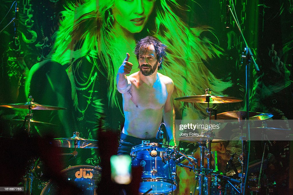 Drummer Johnny Dee of DORO performs in concert at Mojoes on February 13, 2013 in Joliet, Illinois.