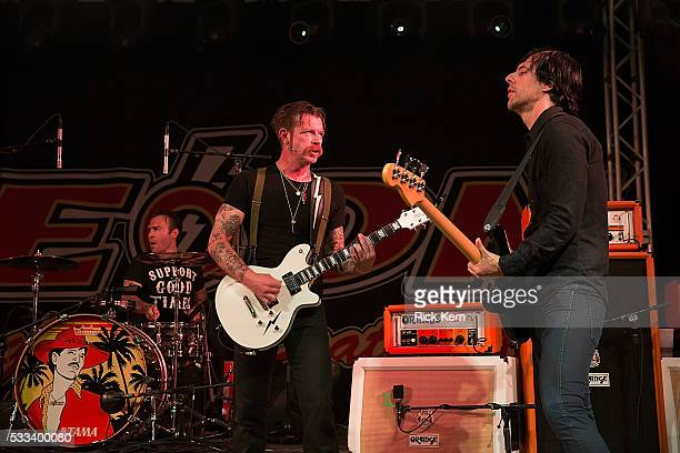 Drummer Jorma Vic singersongwriter Jesse Hughes and Matt McJunkins of the band Eagles of Death Metal performs in concert at Stubb's BarBQ on May 21...