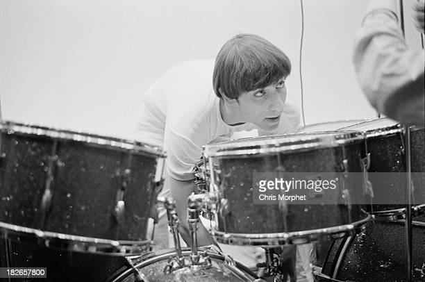 Drummer Keith Moon of English rock group The Who adjusting his kit before a concert in Felixstowe Suffolk 9th September 1966