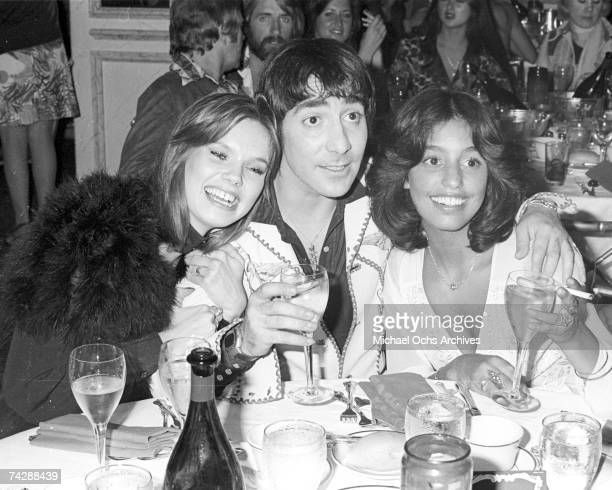 Drummer Keith Moon of The Who at his 28th birthday party with girlfriend Annette WalterLax and groupie Lori Maddox on August 23 1974 at the Beverly...