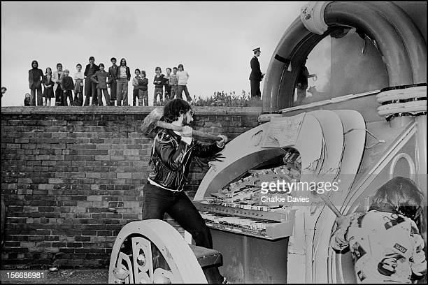 Drummer Keith Moon of The Who destroys the barrel organ used in the Film version of 'Tommy' at Parkhead Stadium Glasgow Scotland 1976