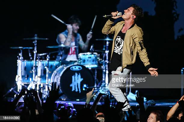 Drummer Louis Vecchio and vocalist David Boyd of New Politics perform at Staples Center on October 13 2013 in Los Angeles California