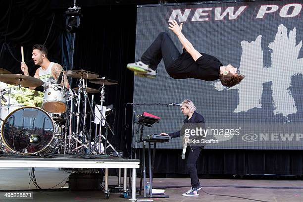 Drummer Louis Vecchio vocalist David Boyd and guitarist Soren Hansen of New Politics perform at Live 105 BDF on June 1 2014 in Mountain View...