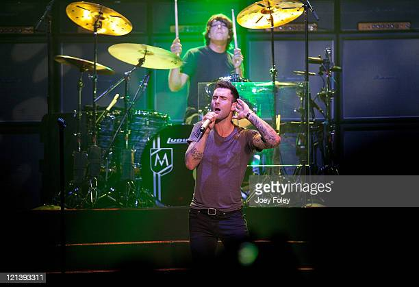 Drummer Matt Flynn and Lead Vocalist Adam Levine of Maroon 5 perform onstage at Conceso Fieldhouse on August 18 2011 in Indianapolis Indiana
