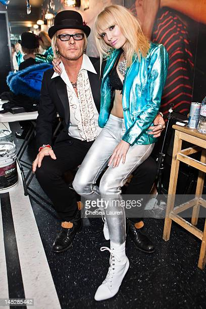 Drummer Matt Sorum and vocalist Ace of Diamonds pose backstage at Diamond Baby performs at The Viper Room on May 24 2012 in West Hollywood California