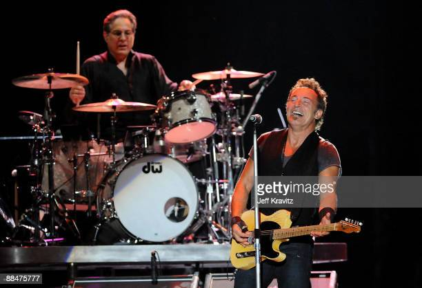 Drummer Max Weinberg and Bruce Springsteen of the E Street Band perform on stage during Bonnaroo 2009 on June 13 2009 in Manchester Tennessee