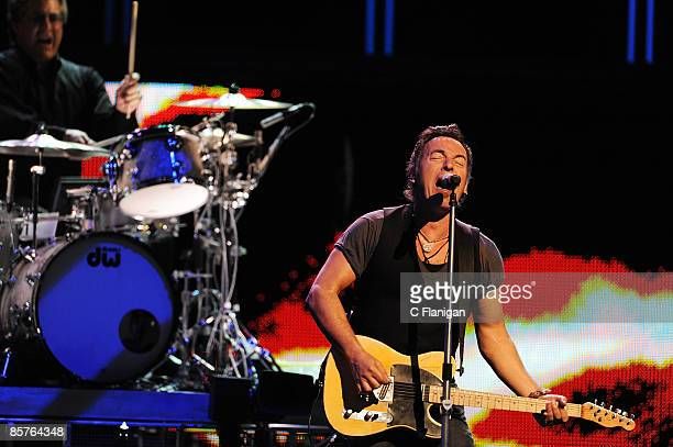 Drummer Max Weinberg and Musician Bruce Springsteen perform live at the HP Pavilion on April 1, 2009 in San Jose, California.