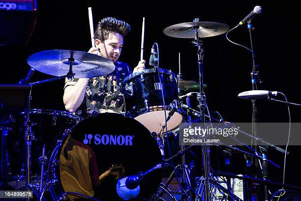 Drummer Michael Johnson of New Beat Fund performs at the Vans Warped Tour press conference and kickoff party at Club Nokia on March 28 2013 in Los...
