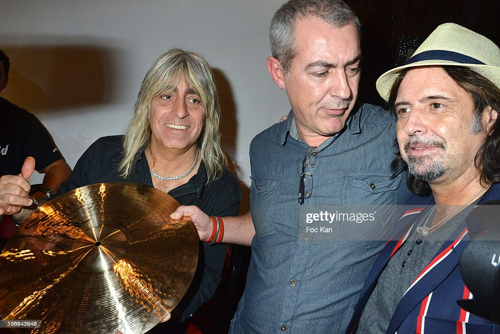 Drummer Mickey Dee, a guest and Guitarist Phil Campbell from Motorhead band attend 'Motorheadphones' Press Conference at the Hard Rock Cafe on November 22, 2012 in Paris, France.