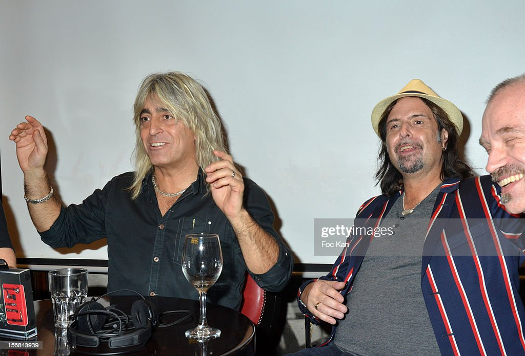 Drummer Mickey Dee and Guitarist Phil Campbell from Motorhead band attend 'Motorheadphones' Press Conference at the Hard Rock Cafe on November 22, 2012 in Paris, France.