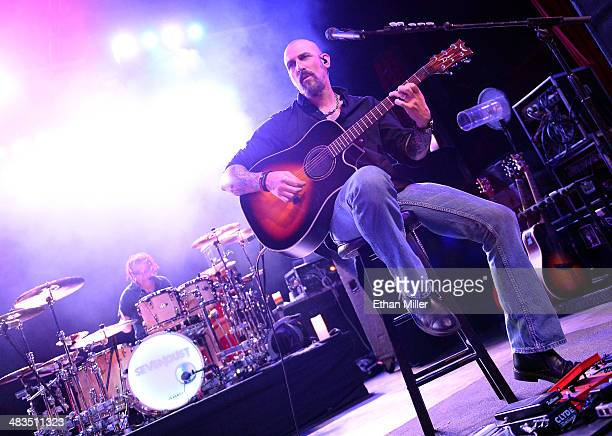 Drummer Morgan Rose and guitarist John Connolly of Sevendust perform during an acoustic concert at the Marquee Theatre as the band tours in support...