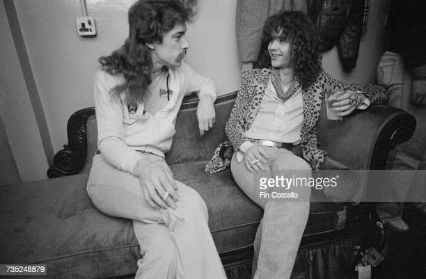 Drummer Neil Peart of Canadian progressive rock band Rush backstage with guitarist Brian Robertson of Thin Lizzy at the Hammersmith Odeon London...