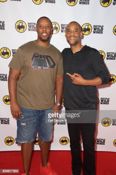 Drummer Nisan Stewart and CoFounder PCF Restaurant Management Karim Webb attend the Buffalo Wild Wings Opening In Koreatown at Buffalo Wild Wings on...