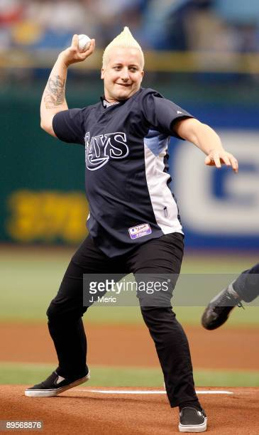 Drummer of the group Green Day Tre Cool throws out the first pitch of the game between the Tampa Bay Rays and the Kansas City Royals at Tropicana...