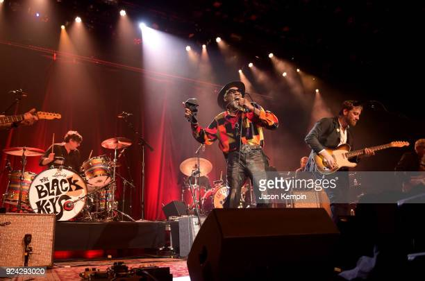 Drummer Patrick Carney Singer Robert Finley and musician Dan Auerbach perform at Ryman Auditorium on February 25 2018 in Nashville Tennessee