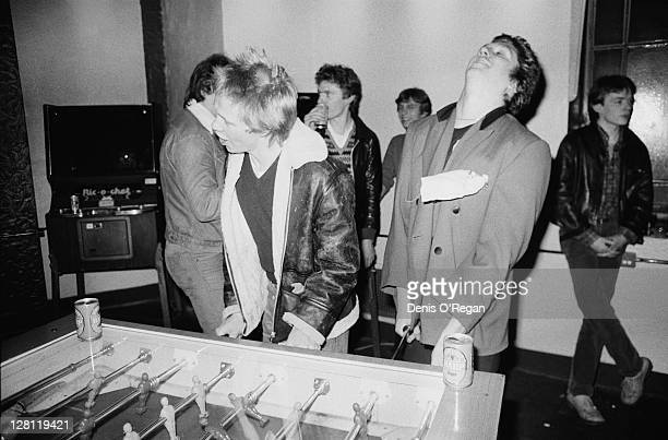 Drummer Paul Cook and guitarist Steve Jones of punk group the Sex Pistols playing table football circa 1978