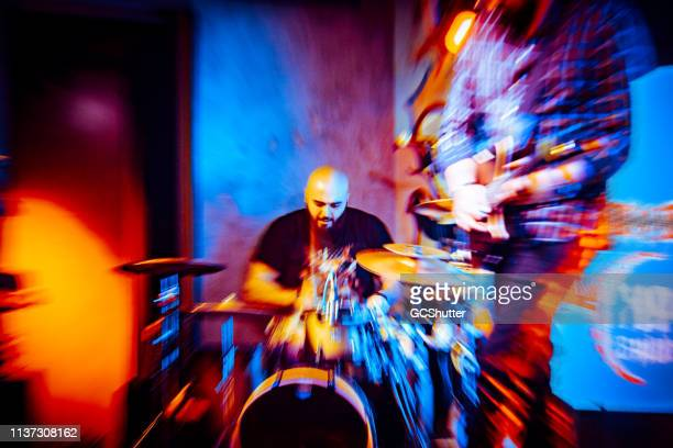 drummer performing at the club - rock music stock pictures, royalty-free photos & images