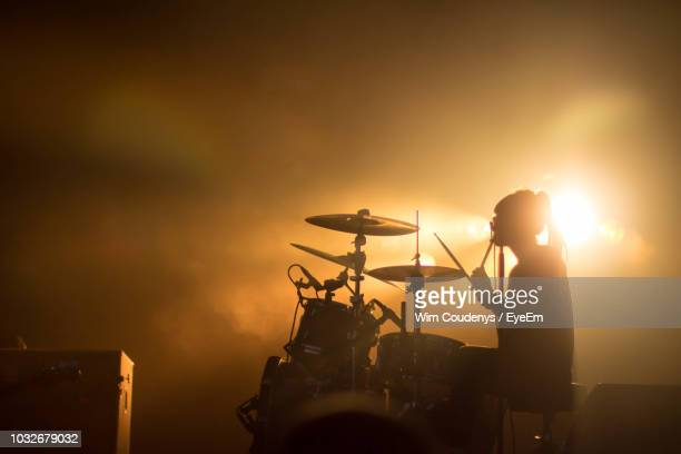 drummer performing on stage during concert - drum kit stock photos and pictures