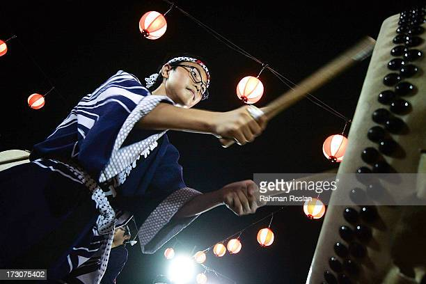 A drummer performs at the Bon Odori festival on July 6 2013 in Shah Alam Malaysia Malaysian and Japanese residents celebrate the Bon Odori festival...
