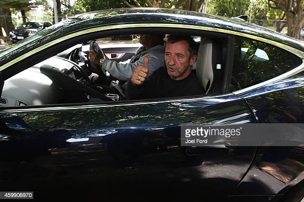 DC drummer Phil Rudd gives thumbs up as he leaves Tauranga District Court after being arrested in relation to breach of bail conditions on December 4...